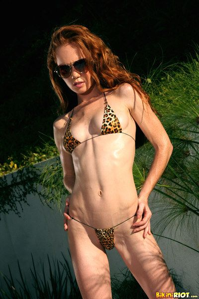 Feel like haired slight redhead Heather Carolin in sunglasses removes her bikini outdoors