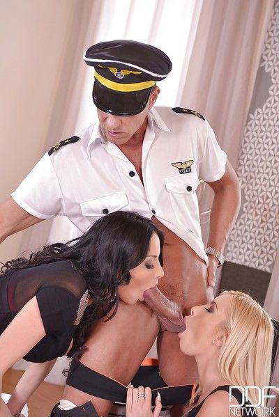 European pornstars Dona Bell and Anissa Kate blow off pilot in high heels