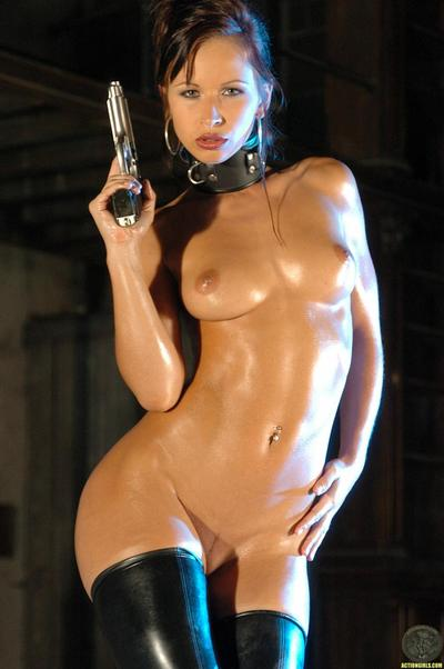 Round assed oiled gal dominant-bitch Susana Spears takes off her black latex outfit in the semi-dark