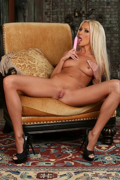Skinny golden-haired with superb forms uses a tense apparatus to awaken her pink vag