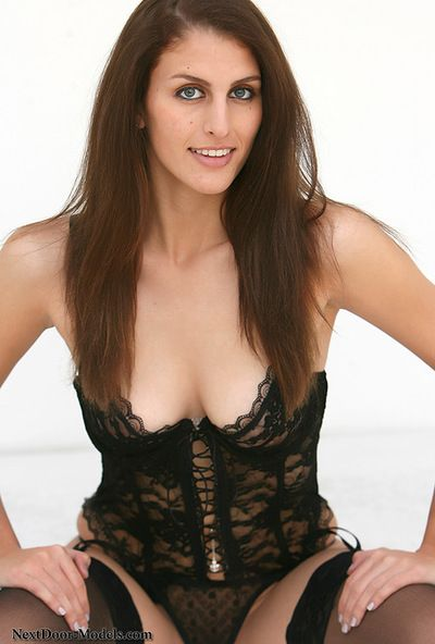 Sweetie in black lingerie posing her bald twat and nasty big tits