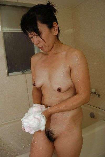 Worthy Asian brunette babe Masako is willing to take a sweaty bath