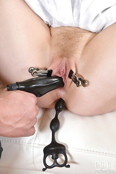 Golden-haired cutie Lola Taylor is pierced and penetrated by perverted BDSM enthusiasts