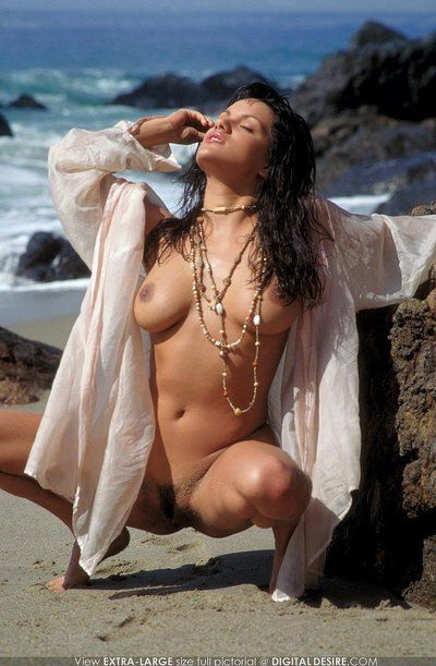 Smoking hot rounded latina babe Monica Mendez with wet black hair poses naked on the beach