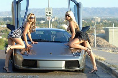 Lez girls Alison Angel and Lia 19 show their milk cans and wet cracks outdoors beside expensive car
