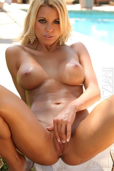 Breasty blonde beauty Nicole Graves gives a hot outdoor striptease by the pool