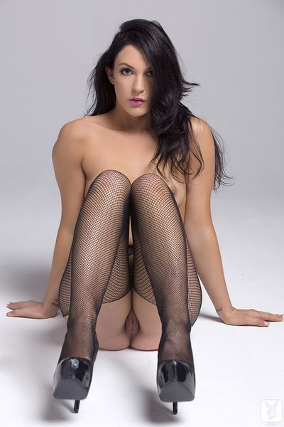 Dark brown gal in sexy fishnet likes to pose dirty and tease with her lovely forms