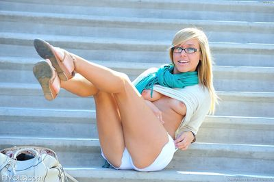 Blonde with sexy glasses enjoys getting nude in public