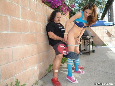 The filthy teen Evilyn Fierce is pleased to swallow and fuck rock hard stick outdoor