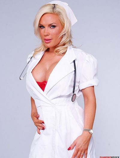 Busty blonde in nusre uniform enjoys posing dirty while moaning in whisper