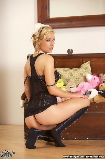 Beautiful blonde Kayden Kross in knee high black socks peels off her lingerie on the floor.