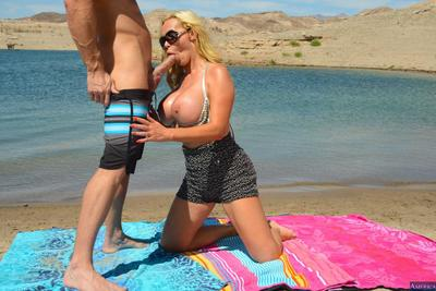 Nikki Benz is hanging out at a beach that\