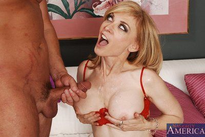Big tit MILF darling Nina Hartley is about to show her hardcore sex skills.