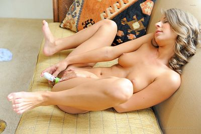 Young beauty keeps open while stretching her sensual shaved cunt