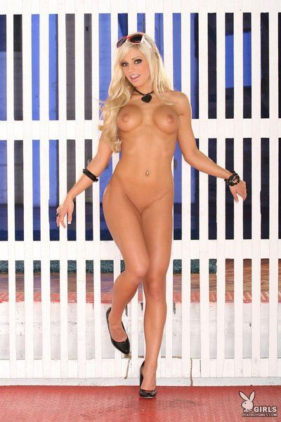 Lusty blonde Corrine Morrill strips her tiny red lace shorts and then poses all naked