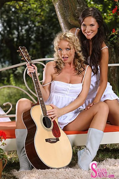 Silvia Saint and Deny Moor are two stunning girlfriends posing together in the garden