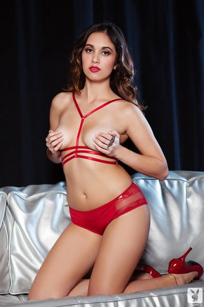 Beauty in red lingerie feels like gently masturbating her pussy twat
