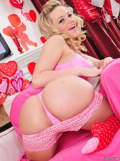 Delicious blonde Alexis Texas in red knee highs strips out of her pink lingerie