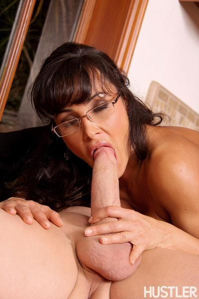 Busty milf brunette Lisa Ann in glasses sucks big cock then takes it up her pussy