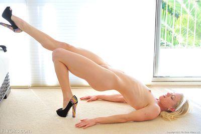 Alluring blonde beauty amazes by deep masturbating her puffy twat