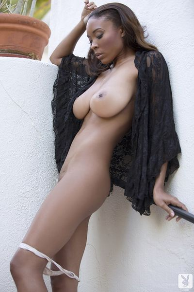 Busty ebony enjoys posing her shaved twat in outdoor solo