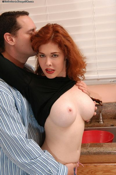 Tattooed man drills hairy snatch of big meloned redhead mom Mae Victoria in the kitchen