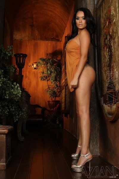 Exotic beauty Daisy Marie with long legs and perfect big boobs takes off her dress