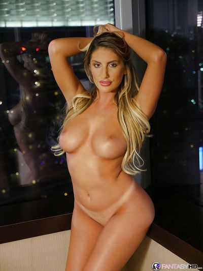 Leggy pornstar August Ames showing off big tits while spreading labia lips