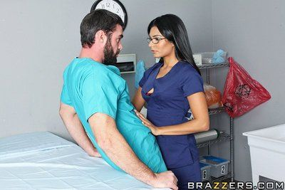 Raven haired glassed nurse Shazia Sahari i black nylons gets her smooth pussy stuffed by coworker