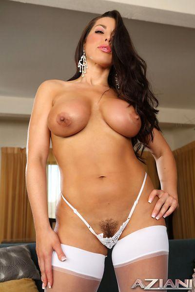 Big boobs brunette stroking a big toy deep in her puffy twat