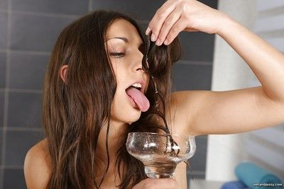 Brunette babe Jimena drinking own piss after peeing into cup