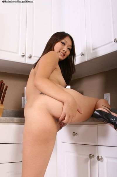 Oriental cutie Evelyn Lin with shaved spot spreads her slim legs with no shame in the kitchen