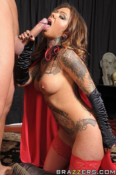 Tattooed busty witch Julia Bond in red stockings gets her pussy hammered