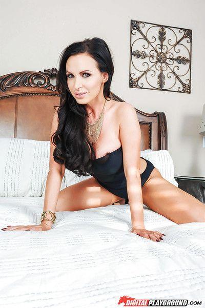 MILF pornstar Nikki Benz revealing round boobs before spreading legs