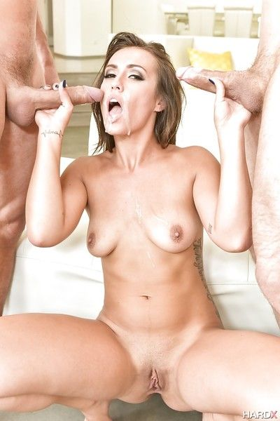 Pornstar Kelsi Monroe giving two fat cocks a blowjob at same time