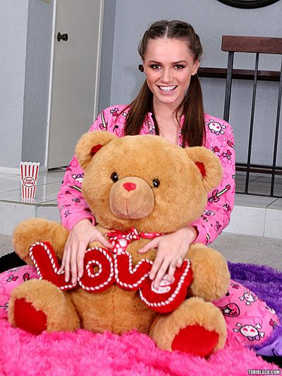 Small titted brown haired cutie Tori Black takes off her pink pajamas and white panties