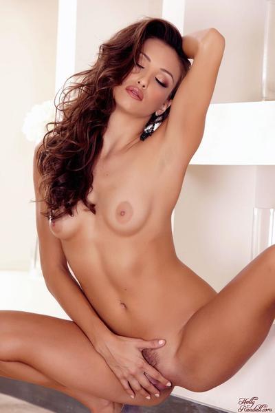 Lusty brunette babe Celeste Star demonstrating the wonderful no panty up skirt view