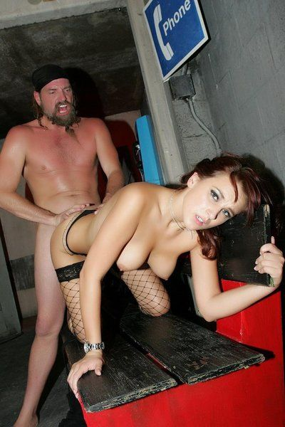 Dani Woodward in fishnet stockings and latex skirt gets fucked by bearded biker