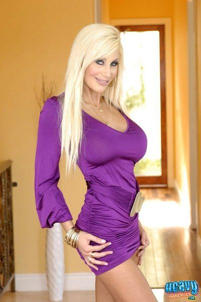 Busty blonde pornstar Puma Swede takes off her violet dress and black panties before POV sex