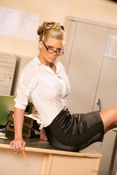 The seducing blonde girl Phoenix Marie is in the office teasing with downblouse and sexy upskirt
