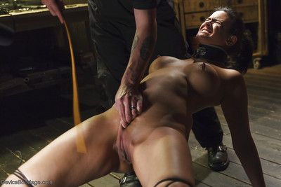 Nerdy MILF Penny Barber chained to floor for painful foot whipping