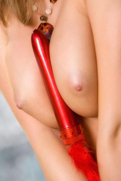 Mesmerizing Carli Banks places red dildo between her perfect firm C-size tits