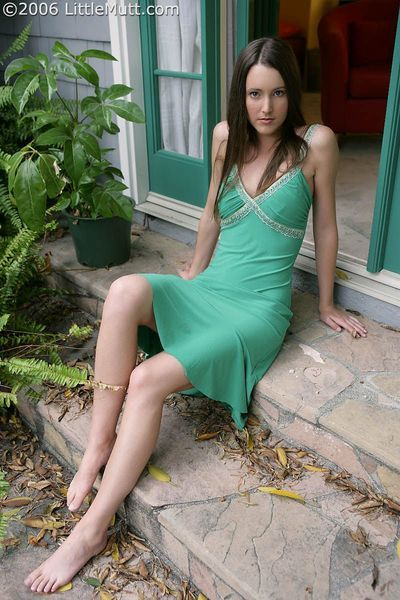 Cute brunette Erica Ellyson with perky boobs removes her green dress in the backyard