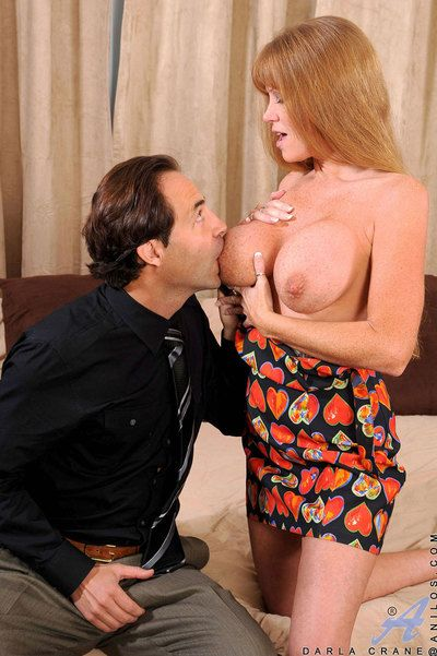 Busty red haired milf Darla Crane blows piston and has it slamming her meaty pussy