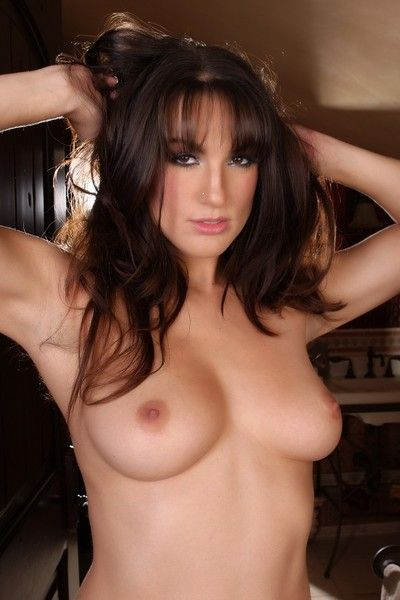 Flirtatious brunette Misty Anderson with sexy boobs and ass strips out of her dress