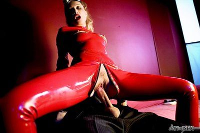 Wrapped in latex costume this frisky girl Sue Diamond gets fucked through the hole