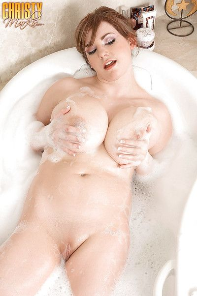 Solo girl Christy Marks displaying nice ass and huge hanging tits in bath