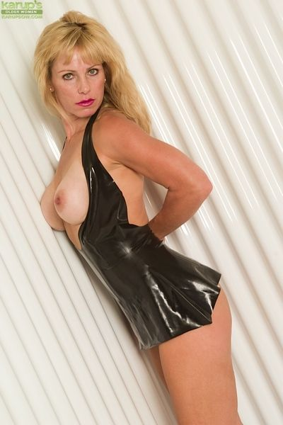 Experienced blonde flashing hairy vagina in latex outfit and boots