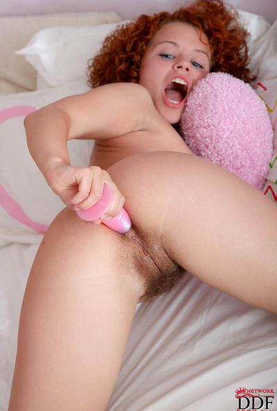 Feeling both dildo and vibrator stimulating her holes makes horny Sunny to go wild