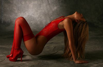 Sensual blonde in red lingerie giving outstanding solo scene while undulating her body